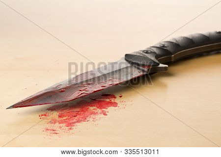 Crime Scene Investigation Csi Evidence Marker With Bloody Knife On Wooden Floor Background At Crime