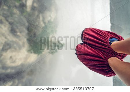 Little Tourist Girl Wearing In Shoe Covers While Standing On Glass Pathway In Tianmenshan Nature Par
