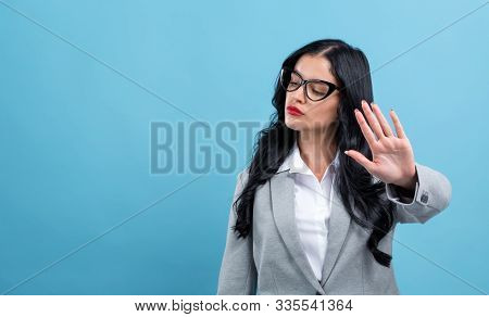 Young Woman Making A Rejection Pose On A Blue Background
