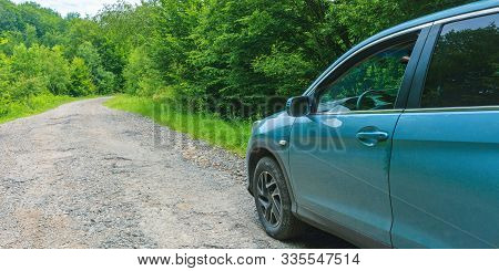 Mnt. Runa, Ukrain - 22 Jun, 2019: Suv On The Old Forest Road. Cyan Blue Vehicle Parked On The Cracke