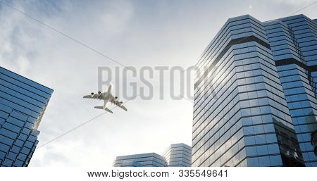 Airplane flies over skyscrapers at the city. 3D render