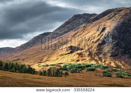 Beam Of Sun Light Hiting The Side Of A Mountain In The Scottish Highlands