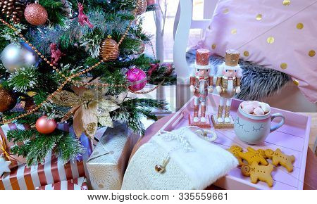 On Trend Pink And Rose Gold Trimmed Christmas Tree With Tray For Santa.