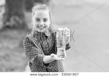 Dont Wait, Hydrate. Bottle Of Potable Water Selective Focus. Little Girl Drinking Water To Quench Th
