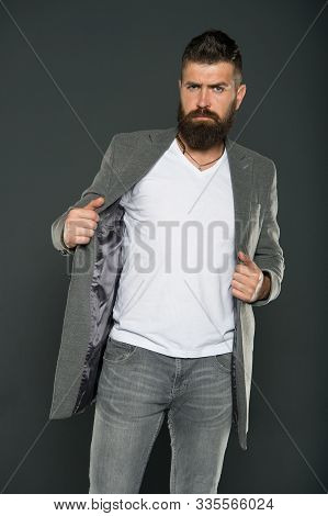 Comfortable Simple Coat. Serious Concentrated Man. Caucasian Man With Brutal Appearance. Bearded Man