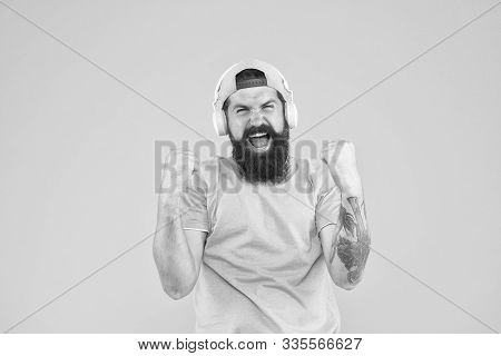 He Isnt Nothing But A Winner. Happy Hipster Shouting And Making Winner Gesture On Yellow Background.