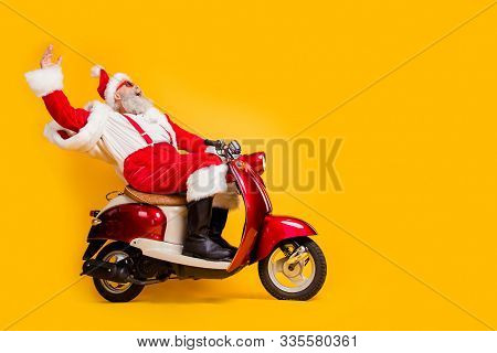 Full Length Profile Side Photo Of Crazy Funky White Bearded Santa Claus Hipster Ride Fast His Scoote