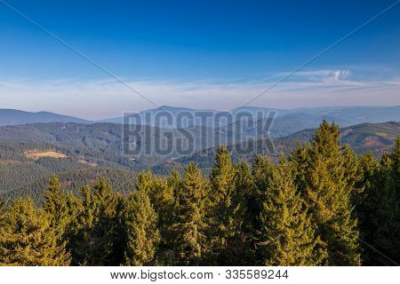 Mountainous Countryside In Northwest Bohemia. View On The Lysa Hora Hill, Highest Mountain Of The Mo