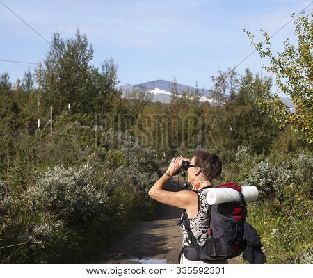 Rural County, Sweden On August 26. View Of A Bird Watcher On A Mountain Trail On August 26, 2019 In
