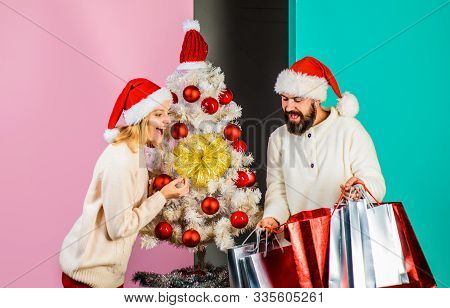 Christmas Sales. Happy Couple Shopping For Christmas In Wintertime. Happy Couple With Shopping Bags