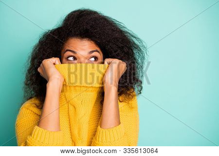 Close Up Photo Of Funny Dark Skin Wavy Lady Hiding Half Facial Expression With Collar Looking Empty