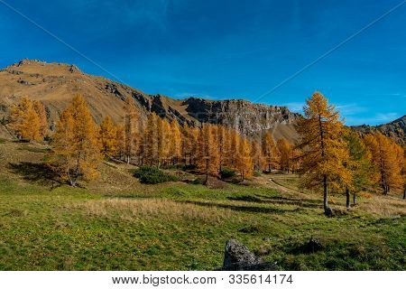 Colourful Autumn View Overlooking The Passo Fedaia Pass Near The Marmolada Massif In South Tyrol