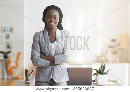Business Career. Portrait Of Successful African American Businesswoman Posing With Arms Crossed At W