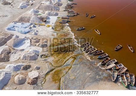 Aerial View Of The Small Boats For Salt Collecting At Pink Lake Retba Or Lac Rose In Senegal. Photo