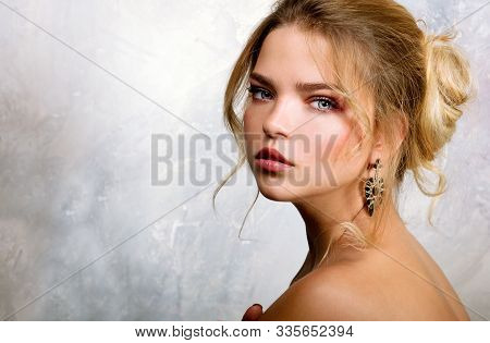Beauty Portrait Of Female Face. Fashion Model Young Woman With Make Up And Hairstyle. Beautiful Girl