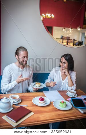 Couple Enjoying Process Of Desserts Revision Before Opening Bakery
