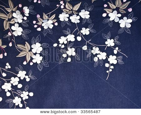 Embroidered Flowers On Denim