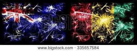 Australia, Ozzie Vs Guinea, Guinean New Year Celebration Sparkling Fireworks Flags Concept Backgroun