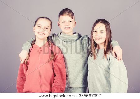 Children Smiling Faces On Violet Background. Friends Hug. Childrens Day. Cheerful Youth. Relations A