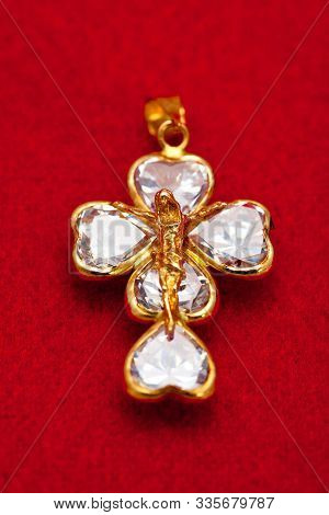 Pendant Of A Crucifix With Five Zirconia Enchased