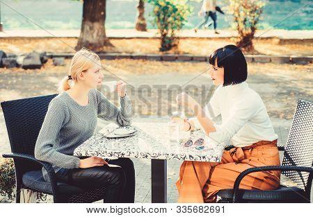 True Friendship Friendly Close Relations. Trust Her. Girls Friends Drink Coffee And Enjoy Talk. Frie