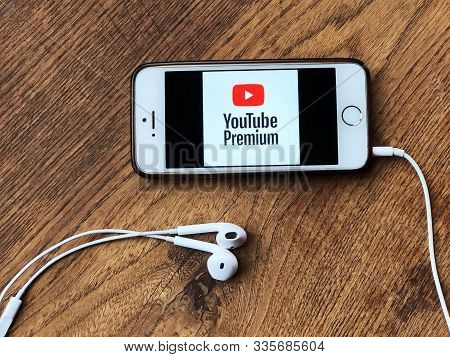November 2019 Parma, Italy: Youtube Premium Company Logo Icon Close-up On Smartphone Screen On Woode