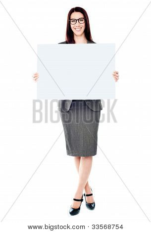 Portrait Of A Business Lady Holding A Blank Billboard