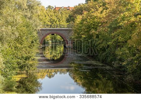 View Of Historic Bridges At Karl Heine Canal In Leipzig / Germany With A Newly Created Bicycle And H