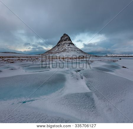 Famous Mountain With Waterfalls In Iceland, Kirkjufell, Winter In Iceland, Ice And Snow, Reflections
