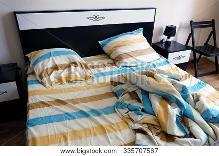 Striped Sheets, Pillows And Duvet Cover On The Bed.