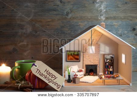 Miniature Thanksgiving House Surrounded By Autumn Leaves