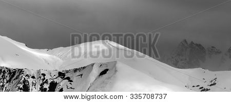 Panoramic View On Sunlight Mountains With Snow Cornice And Trace From Avalanche Before Blizzard. Cau