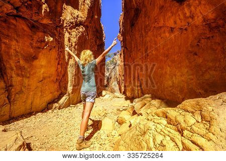 Happy Tourist Woman Enjoying Inside Picturesque Natural Alleyway Of Standley Chasm, An Aboriginal La