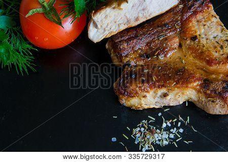 Roasted Pork Meat Seasoned With Salt And Black Pepper