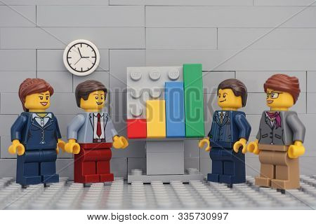 Tambov, Russian Federation - November 23, 2019 Lego Minifigure Businessmen Having A Meeting And Disc
