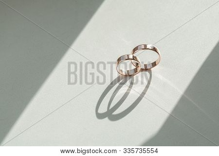 Wedding Rings On Wedding Card On A White Background, Two Golden Wedding Rings Isolated On White, Wed