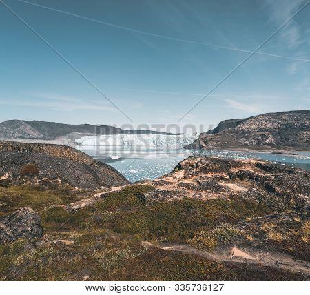 Greenland, Eqip Sermia, Eqi Glacier In Greenland Disko Bay. Boat Trip In The Morning Over The Arctic