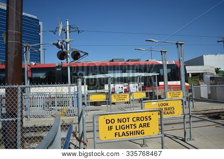 Pedestrian Transit Train Crossing With Warning Lights With Transit Train.