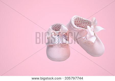 Baby Shoes, Pink Baby Girl Shoes Isolated On Pink Pastel Colored Background. Clipping Path Included