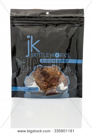 Winneconne, Wi - 1 November 2019: A  Package Of Jk Brittle Works Brittle In Pecan Flavor On An Isola