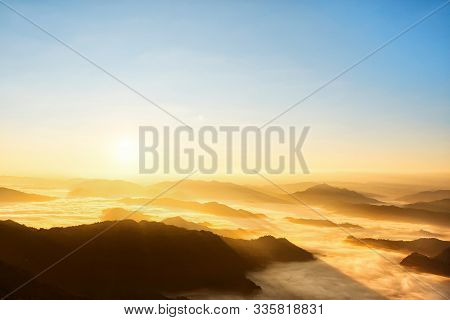 Beautiful Scenic Sunrise View Above The Mountains With Cloud Moving Or Mist.colorful Orange Sky With