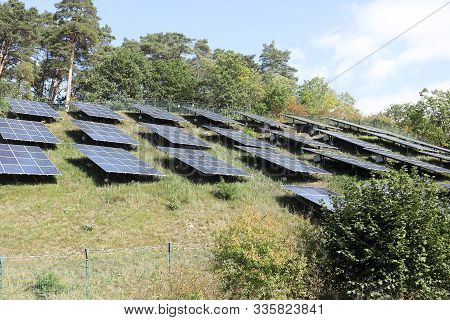 Solar Panel On Sky  And Trees Background. Photovoltaic Power Supply Systems. Solar Power Plant. The