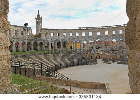 Ancient Roman Amphitheater In Sunny Day In Pula, Istria, Croatia, Europe. Roman Colosseum. An Arena