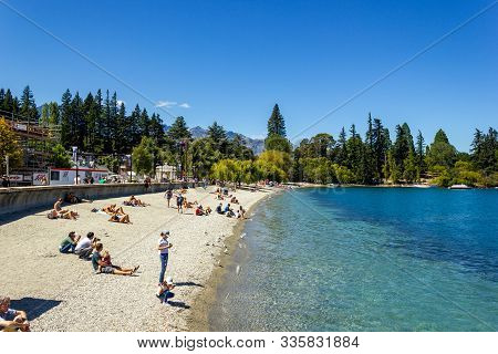 Queenstown, New Zealand - February 14, 2016: Tourists Walking On The Streets Near Wakatipu Lake, Que