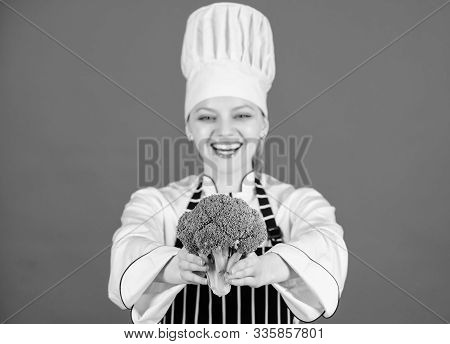 From The Food And Nutrition Expert. Happy Woman Holding Fresh Green Broccoli. Lady Cook Smiling With