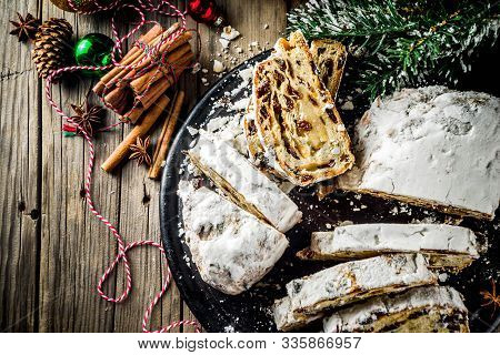 Traditional European Christmas Pastry, Fragrant Home Baked Stollen, With Spices And Dried Fruit. Sli