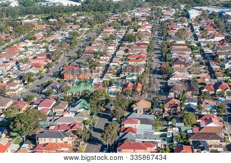 Aerial View Of Urban Suburb Residential Area With Houses And Street. Drone View From Above, Aerial P