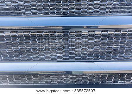 Mesh Car. Radiator Grille. Metal Texture. The Radiator Grill Is Large Powerful. The Front Of The Car