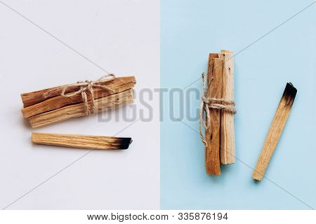 Palo Santo Sticks On A White And Blue Background. They Are Used In Aromatherapy And Religious Rites