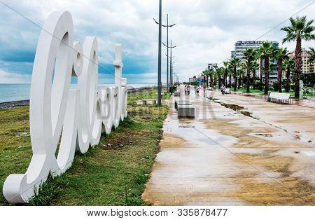 Installation letters Liberte on the beach in Batumi after the rain, Georgia